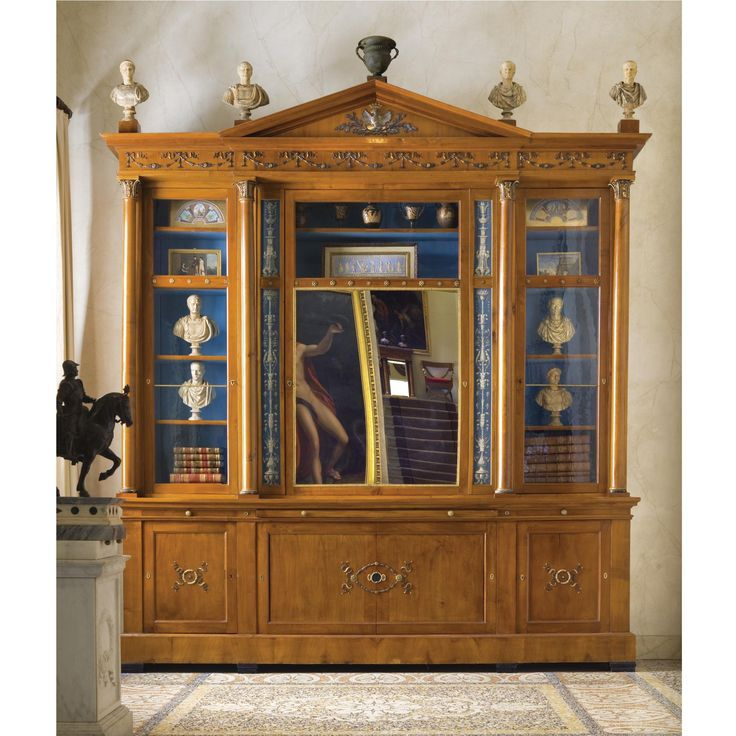 """""""FURNITURE FROM THE COLLECTION OF GIANNI VERSACE VILLA FONTANELLE, MOLTRASIO."""": AN IMPORTANT ITALIAN GILT-AND PATINATED BRONZE-MOUNTED CHERRYWOOD BREAKFRONT BOOKCASE BY KARL ROOS, THE MOUNTS BY GIUSEPPE SPAGNA, AFTER DESIGNS BY GIUSEPPE VALADIER CIRCA 1814. Sotheby's"""