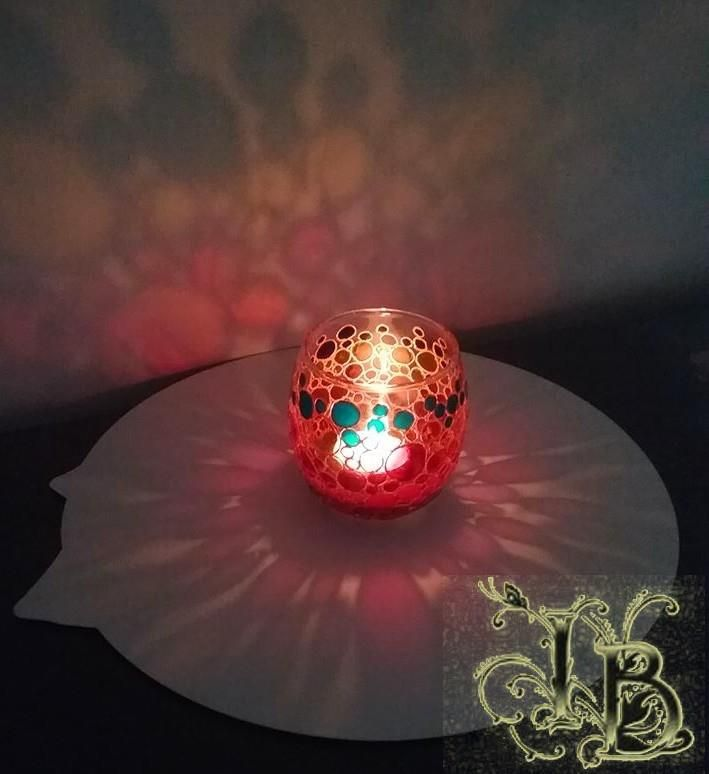 """Candle Holder called """"Bubbles"""". Using special transparent and opaque colors to make light effects. Applying permanent waterproof paint."""