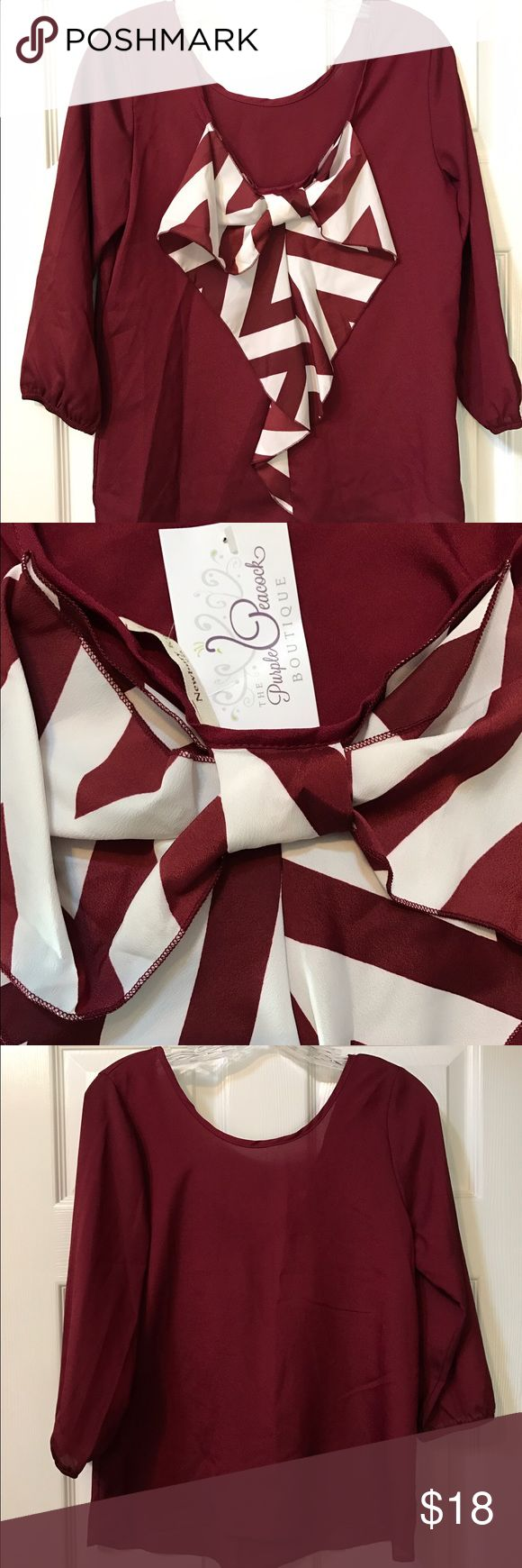 Bow back boutique blouse Perfect for gameday! Burgundy and white chevron bow on the back, quarter length sleeves boutique blouse. Never worn Tops Blouses