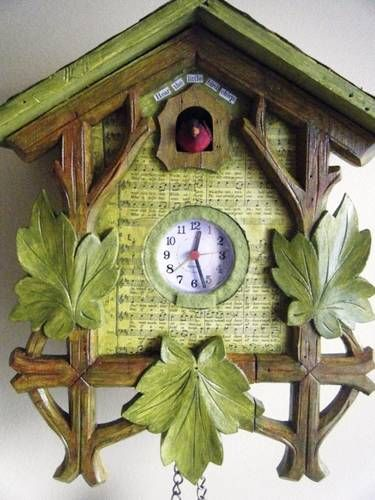 repurposed cuckoo clock .. super cute - stuck in a dollar store clock that worked. I <3 it.