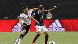 Amel Majri of France controls the ball against Celia Sasic of Germany