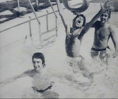 Freddie, John Deacon and Roger Taylor in the pool.