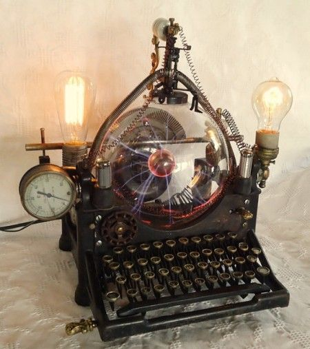 Vintage Typewriter Turned into a Steampunk Lamp. Called 'The Victorian Plasma Supercomputer', this is a one-of-a-kind steampunk-themed desk lamp made from a vintage typewriter and various upcycled materials, combined with vintage-style light bulbs and a glass plasma ball. Created by Dr. Avius Anakron.