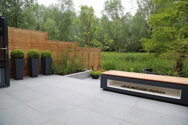 Blue Grey Granite Paving has been used in this contemporary riverside garden by Rosemary Coldstream.