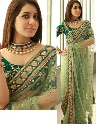 Light green embroidered net saree with blouse at Mirraw
