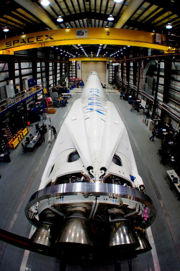 The Falcon 9 rocket sits in SpaceX's hangar at Cape Canaveral Air Force Station in Florida, preparing to launch the company's Dragon spacecraft to the International Space Station. Launch is scheduled for 4:41 a.m. EDT on Sunday, March 16.