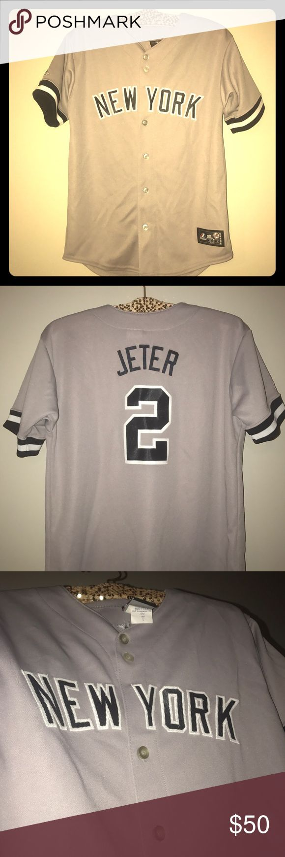 Authentic NY Yankees Jeter Jersey This is an authentic NY Yankees Derek Jeter jersey that was not made by an knock off brand. It was purchased from a Major Leagues merchandising company that distributes jerseys and sports team merchandise to ML stadiums only. It is brand new and never been worn because I wasn't able to go to the game that I planned to wear it to. Never gotten the chance to go again so I want to pass it on to another Yankees fan!! Majestic Tops Button Down Shirts