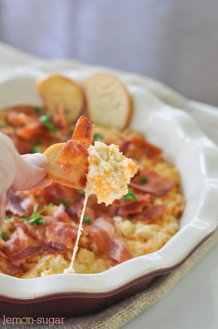 Hot and bubbly out of the oven, this creamy, cheesy dip is topped with bacon and makes a perfect party appetizer. Serve with bagel or corn chips and enjoy!