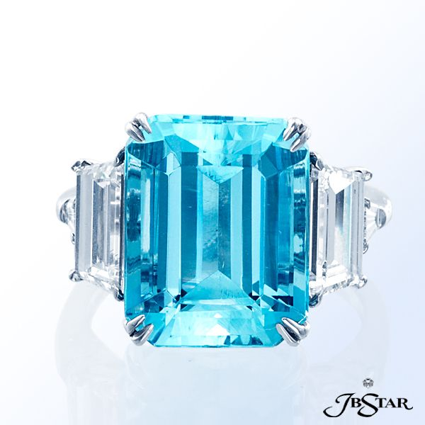 Style 7187 Beautiful emerald-cut aquamarine and diamond ring embraced by trapezoid and baguette diamonds. Platinum.