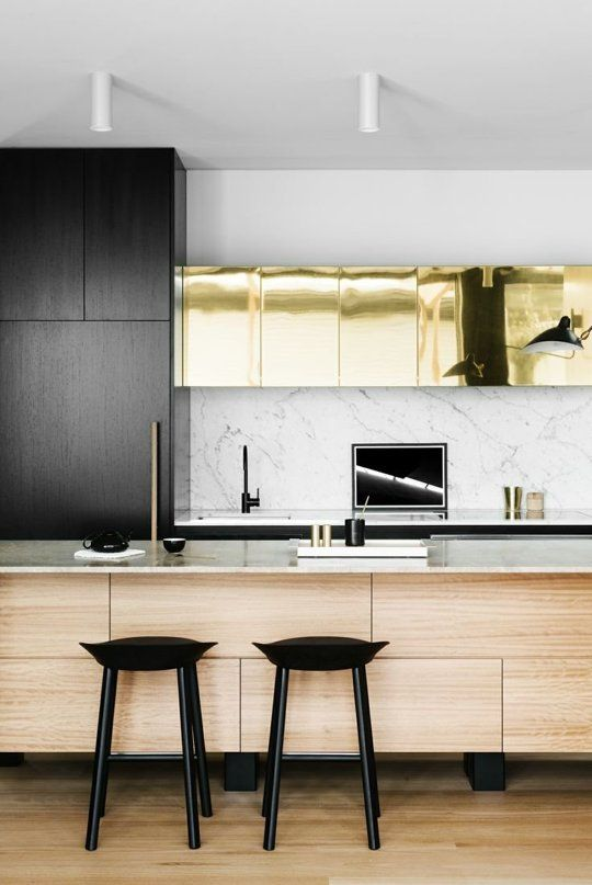A stunning Fiona Lynch kitchen.  Gold cabinets are totally unexpected and quite beautiful against the espresso stained timber and marble.