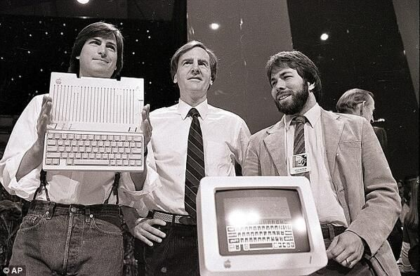 Steve Jobs, John Sculley and Steve Wozniak unveiling a new Apple II series computer. 1984