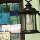 The Alcott Hill® Morrissey One-Light Wall Lantern brings antique-style illumination to your outdoor space. This traditional lantern is made from steel with a rich oil rubbed bronze finish for a vintage look. The lantern's scroll arm, tiered roof, and rustic clear seeded glass panels exude an attractive aged quality. Install this lantern in front or back entryways or use as an accent on porches, deck areas, patios, or balconies.