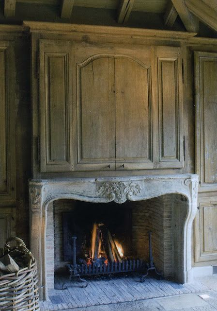 French Country...great way to hide tv above a fireplace!