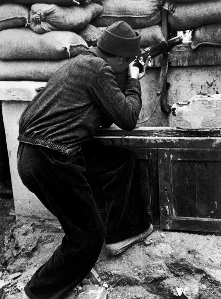 International Brigades member in the University of Madrid holding off a Nationalist siege attempt. Robert Capa, 1936.