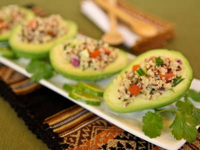 Quinoa stuffed avocado: Prepare quinoa according to package directions. Fluff with a fork and transfer to a large bowl. Mix in the red onion, cucumber, tomatoes, cilantro, olive oil, vinegar and salt. Cut each avocado in half and gently scoop out of the shell, keeping it intact. Scoop the quinoa salad into the center of each avocado. Serve immediately.