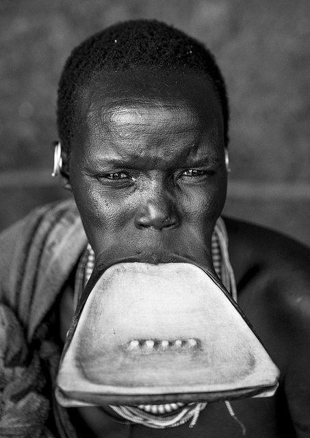 faces,Suri woman with triangular lip plate, Kibish Omo Ethiopia by Eric Lafforgue, via Flickr