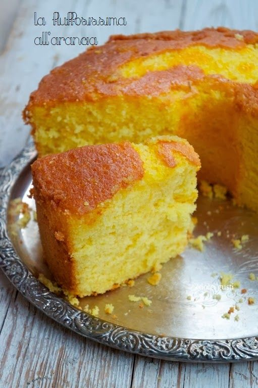 fluffy fluffy orange cake.  conversions: 1.5 cups sugar, 2.25 cups flour, 210 mL OJ, 4 oz olive oil--make with 4 eggs instead of 7