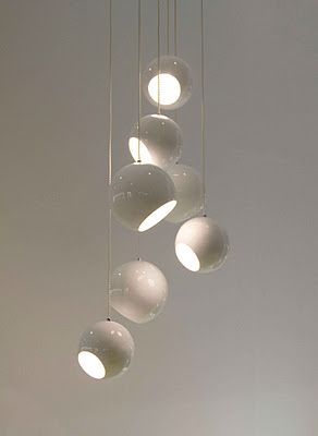 So beautiful. It is interesting how a lamp which is made of many little pieces or lights, can work like a sculpture hanging from the ceiling. This one, is like a exclusive different lamp. The little globes are more organic than triangles and squares, and also the group-lamp create movement and rhythm. The functionality is special as well, by the balls pointing different directions.