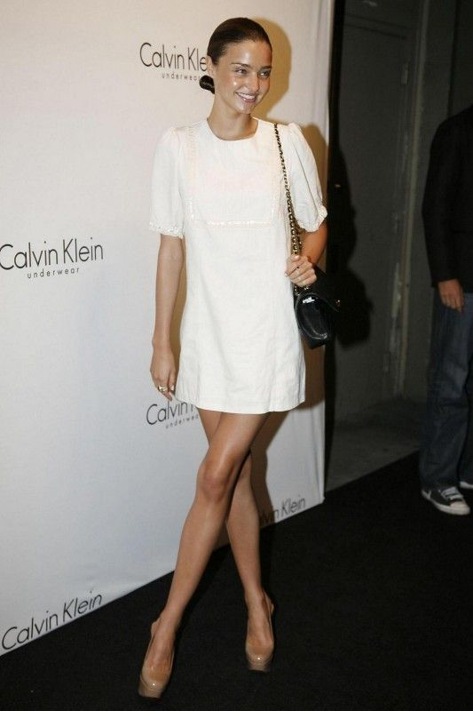 Miranda Kerr wearing Chanel 2.55 Classic Flap Bag and Calvin Klein Collection Spring 2007 Dress.