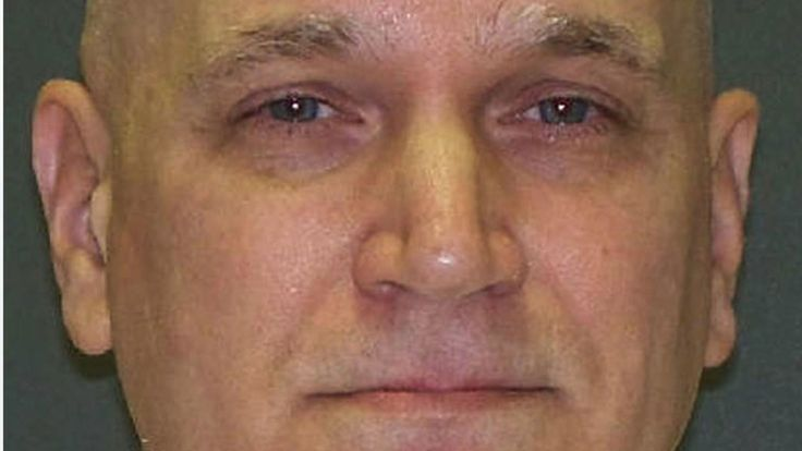 John Battaglia, who called his estranged wife as he shot their daughters in 2001, smiled as she watched his execution in Texas.