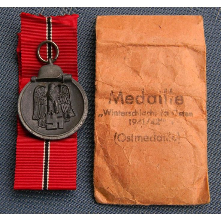 A 1941 - 42 EAST MEDAL MARKED 76 WITH PAPER BAG - Medals Military