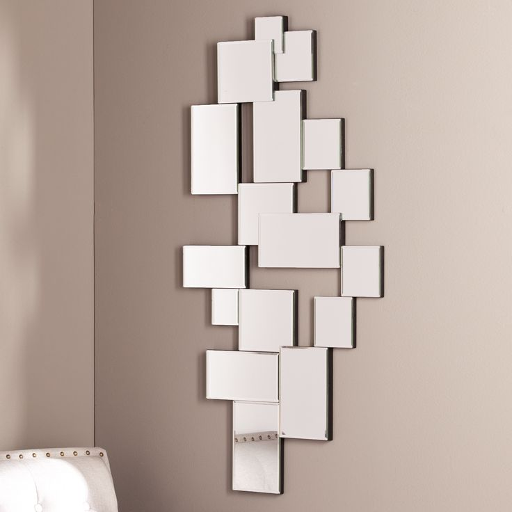Liven up your wall space with this Upton Home geometric, mirrored wall art. Seventeen angular mirrors hang together, shimmering from every angle to make any space larger than life.