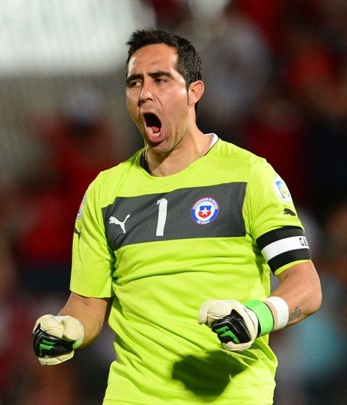 Chile's goalkeeper Claudio Bravo celebrates after teammate Esteban Paredes scored against Uruguay