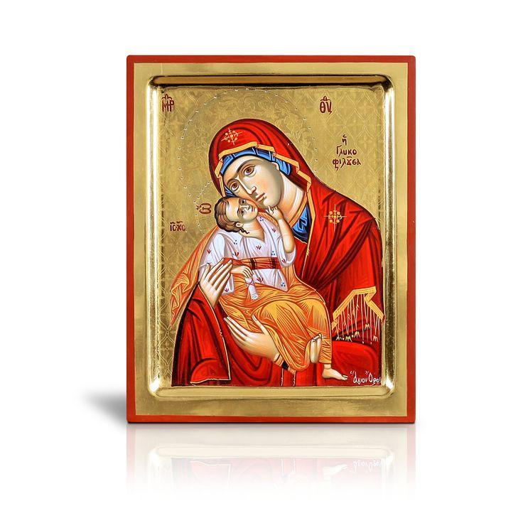 Ο μικρός Χριστός εικονίζεται να κάθεται άνετα στην αγκαλιά της μητέρας του, χαϊδεύοντας το μάγουλο της με το αριστερό του χέρι, ενώ με το δεξί κρατά κλειστό ειλητάριο. Έχει φιλοτεχνηθεί στο Άγιον Όρος. - The infant Christ is depicted sitting comfortably in his mother's lap. He is stroking tenderly his Mother's cheek with his left hand while holding a closed scroll with his right one. It has been painted on Mount Athos.