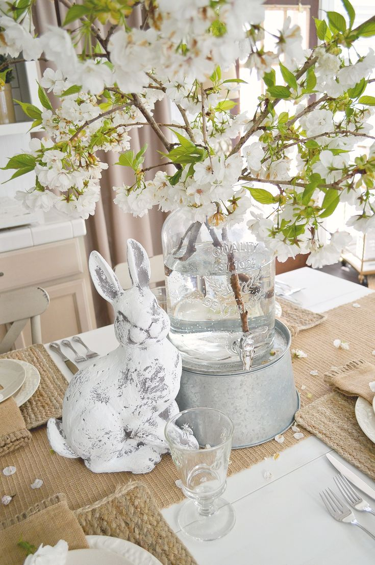 Table setting tip: Use a glass beverage dispenser as a make shift vase for XL floweres and branches! Use what you've got for affordable home decorating. Better Homes & Gardens at Walmart. Simple Spring Cottage Farmhouse Easter Table - Fox Hollow Cottage