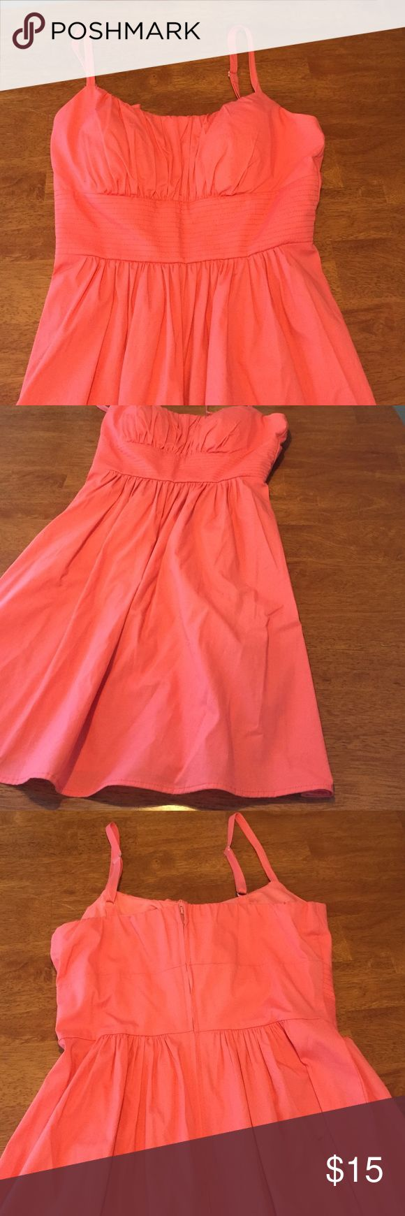 Coral flowy dress. Great condition looks like new! Coral colored. Adjustable straps. Padding in the boobs. Thick waistband. Great summer dress. Feel free to bundle especially with the white polka dot dress. No trades sorry. Obviously just needs a little ironing which i can do easily before shipping it out. B. Smart Dresses Mini