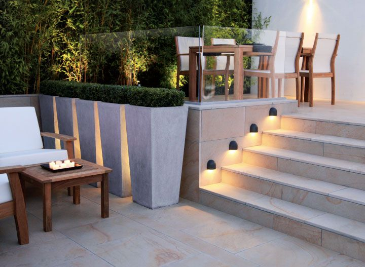 contemporary planters with square clipped box and lighting set between