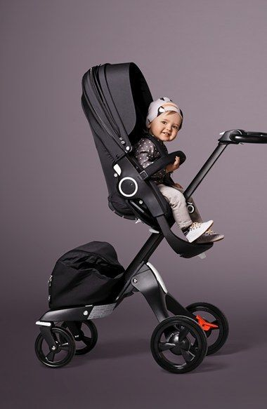 Stokke 'Xplory® - True Black Chassis' Stroller & Accessories // WORTH IT. All the customizable features to lower up and down. And lean forward and back. It looks BOMB and innovtive. Baby can fall asleep and eat and play in it great. Awesome for restaurants and cruising around town. We've even gone off road hiking with it. LOVE LOVE this stroller for a single baby!
