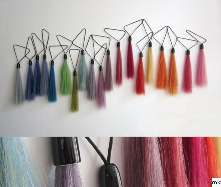 Rainbow of Porcelain: A rainbow of the brightest coloursof horsehair. Combined with blackporcelain caps and black leather cords.The black lines makes a beautifullcontrast with the almost fluffy-like tail.