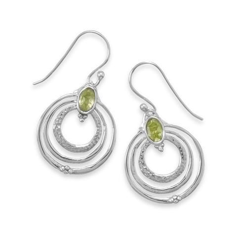 The Peridot Earrings in Sterling Silver Triple Hoops feature oxidized Sterling Silver triple circles on...