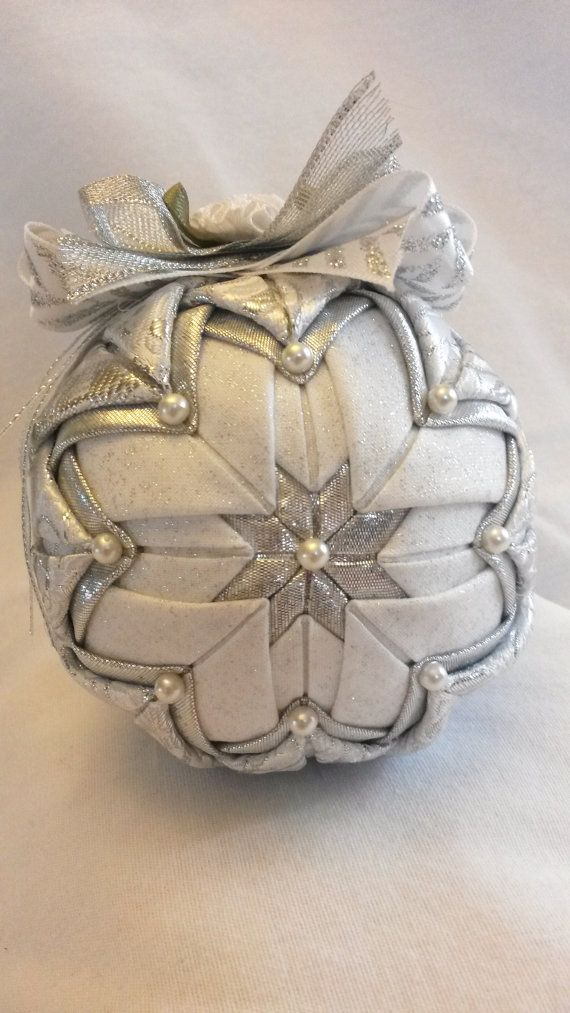 This ornament is made with white and silver brocade and silver lame