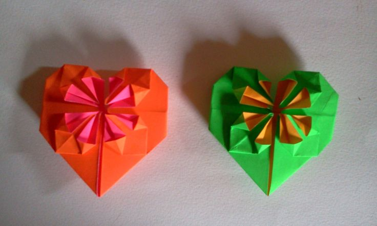 origami heart, this video link in you tube http://youtu.be/1T4gsusO_Js