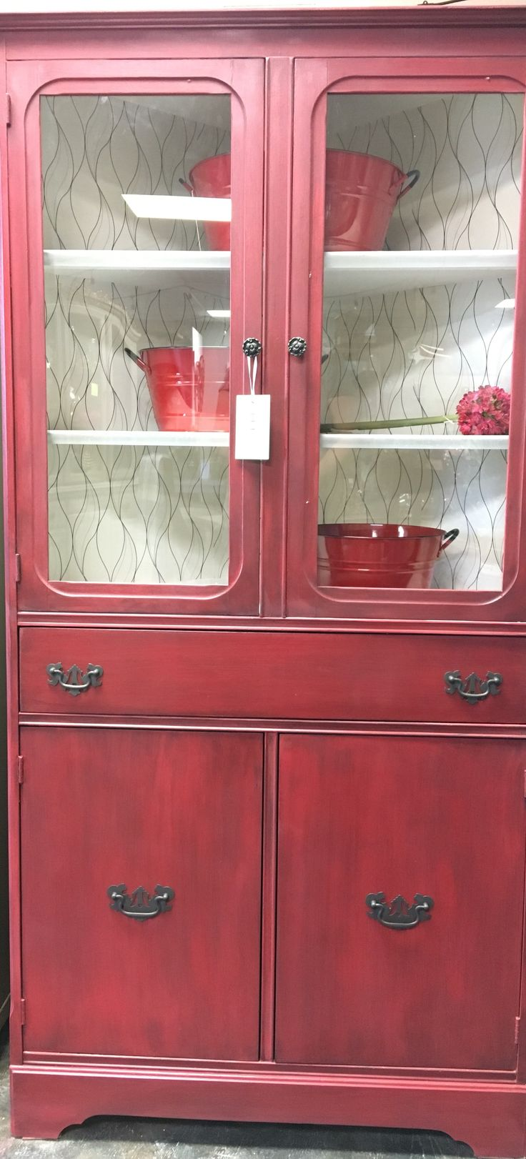 Antique corner cabinet with a new lease in life. Deep red with white
