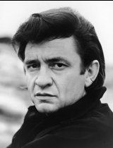 Johnny Cash poses for a promotional head shot portrait for his television variety show, The Johnny Cash Show circa 1969.
