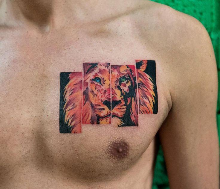 Colorful lion chest tattoo by @georgiagreynyc