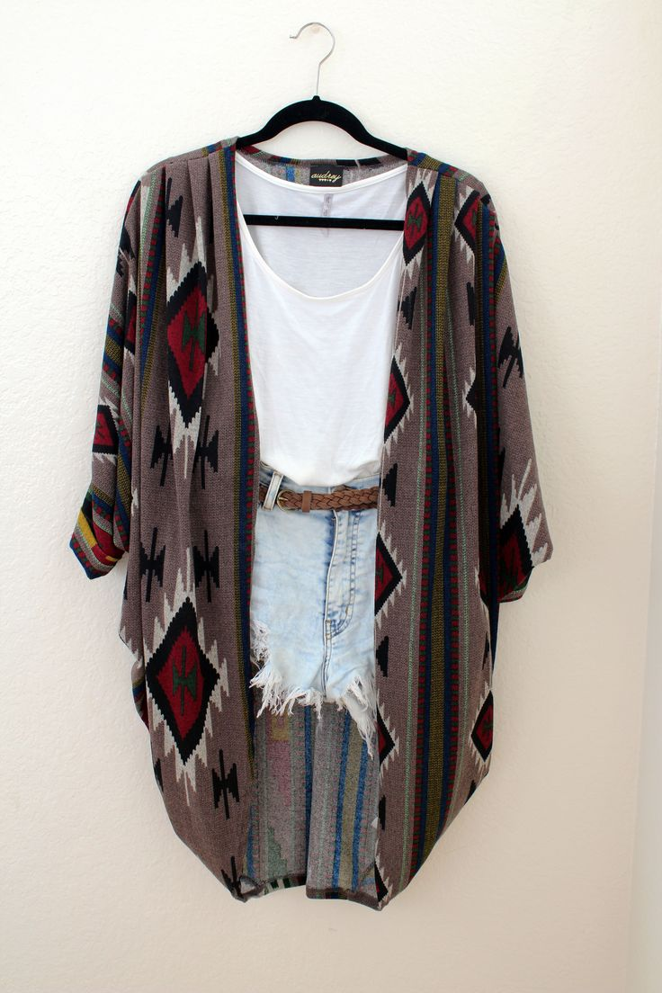 One Size  Colorful Aztec Print on a Taupe-Brownish Base  Open-Cardigan with a rounded drape  Perfect thick but light-weight material  Will definitely keep you cozy during the cold weather!