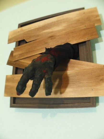 (this one is a zombie hand in the air vent or window) 15 Easy   Awesome DIY Halloween Decorations