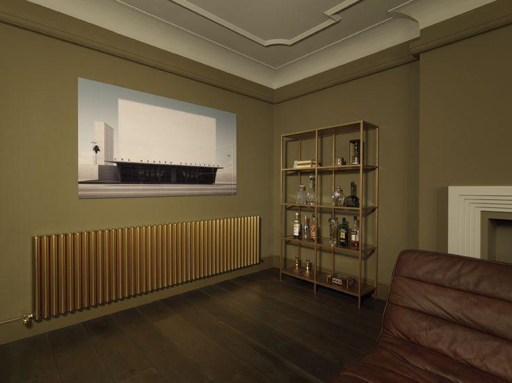 RON radiator from Eskimo. Gold anodised finish. Cinema room. www.eskimodesign.co..uk
