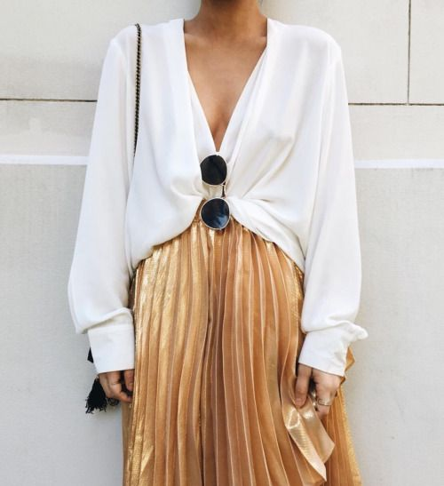 White chiffon blouse with pleated gold skirt