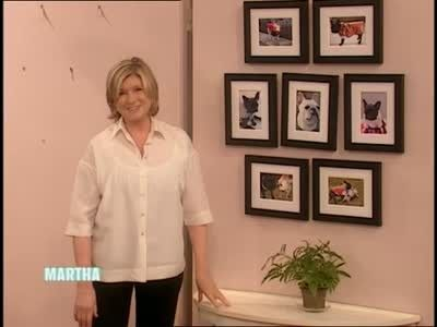 Martha Stewart hangs a group of framed digital photos with a paper wall template.