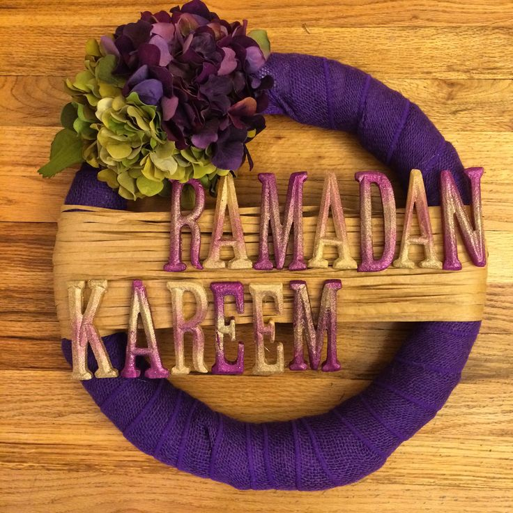 My first ever Ramadan wreath. Bought a styrophoam base, wrapped in burlap, added flowers, wrapped a thin ribbon to stick spray painted letters on.