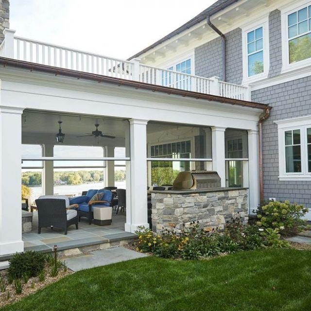 covered bluestone patio flat roof deck