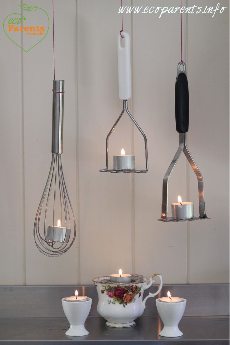 A tea cup and strainer, egg cups, potato mashers and whisk all make acceptable candle holders.