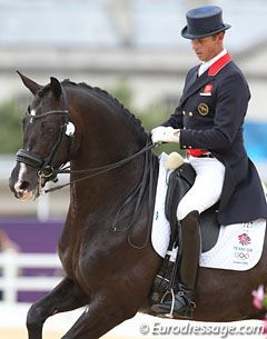 Carl Hester ,Uthopia   This is one of the few recent dressage pictures where the horse is on the bit and not behind it.  They look totally in sync!