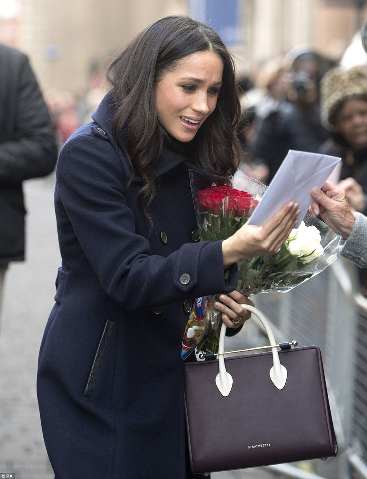 Meghan was carrying a £530 handbag by Scottish brand Strathberry in burgundy as she met wi...