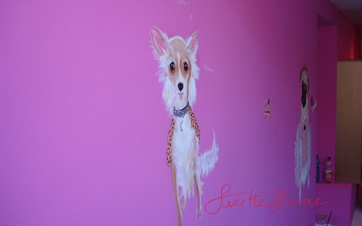 Suzette paints on walls.  This is for a Dogshop VIPDOG in Amsterdam.
